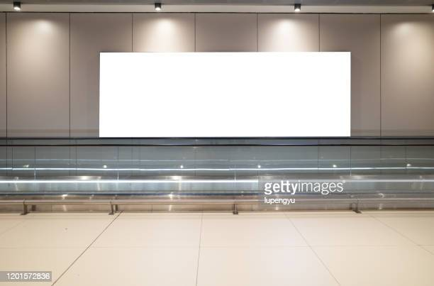 blank billboard at airport - pedestrian walkway stock pictures, royalty-free photos & images