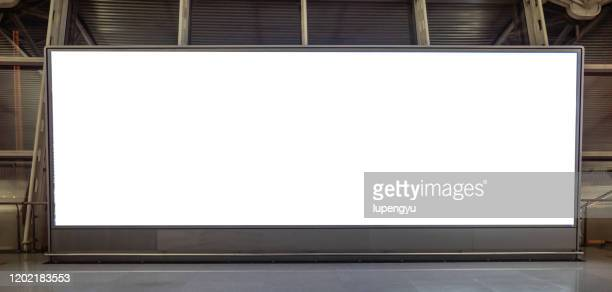 blank billboard at airport - billboard stock pictures, royalty-free photos & images