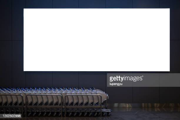 blank billboard at airport - poster stock pictures, royalty-free photos & images