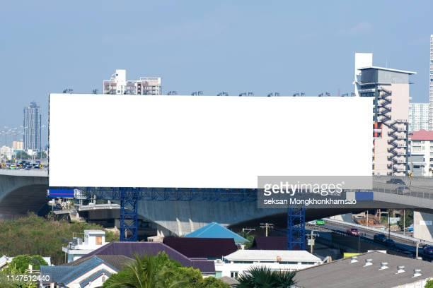 blank billboard at blue sky background - copy space imagens e fotografias de stock