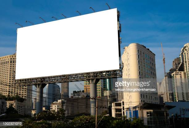 blank billboard at blue sky background - billboard highway stock pictures, royalty-free photos & images