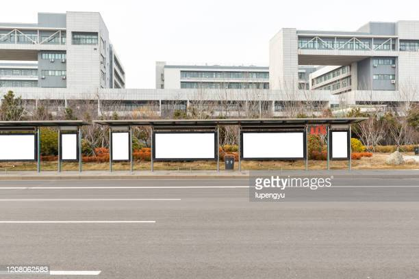 blank billboard at bus station - billboard highway stock pictures, royalty-free photos & images