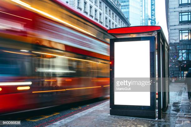 blank billboard at bus station - britain stock pictures, royalty-free photos & images