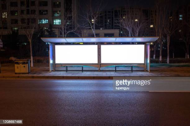 blank billboard at bus stop - advertisement stock pictures, royalty-free photos & images