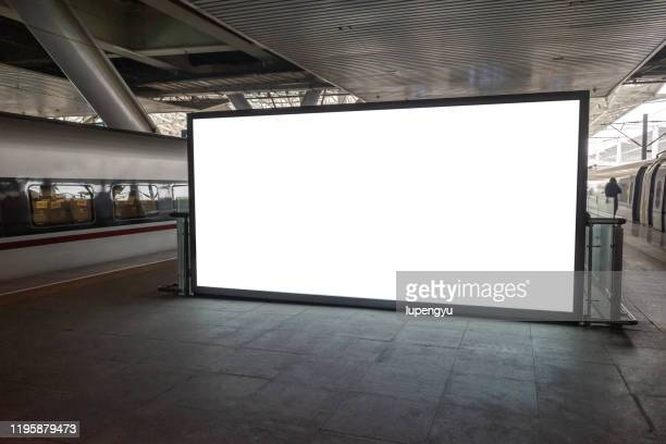 blank billboard at railroad station - bahnhof stock-fotos und bilder