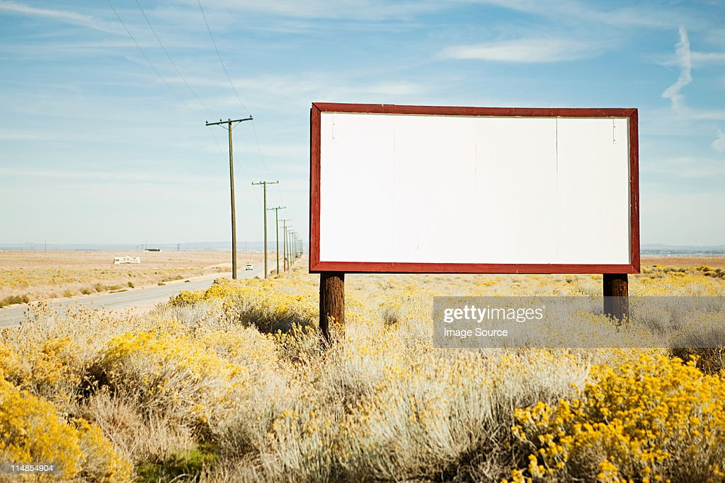 Blank billboard at roadside : Stock Photo