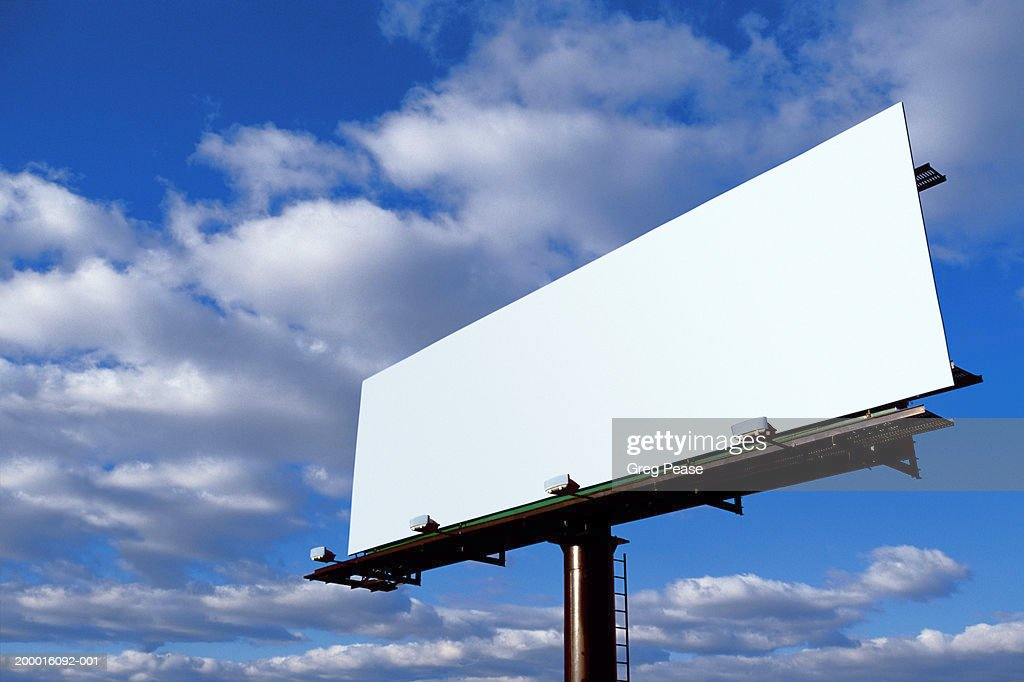 Blank billboard, clouds in blue sky, low angle view : Foto de stock