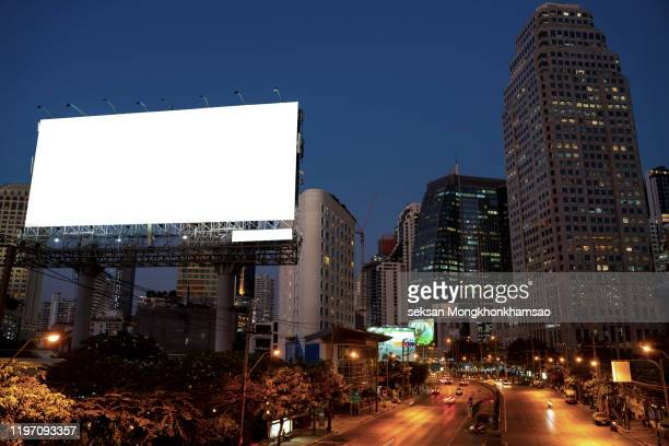 blank billboard for advertisement at night time with street light - billboard highway stock pictures, royalty-free photos & images