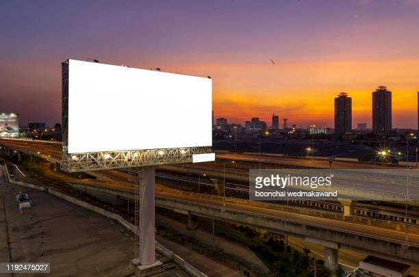 blank billboard for outdoor advertising at twilight time - billboard highway stock pictures, royalty-free photos & images