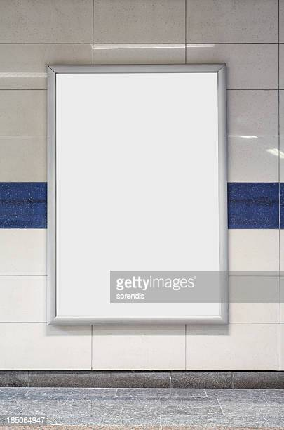 Blank billboard in a subway station wall.