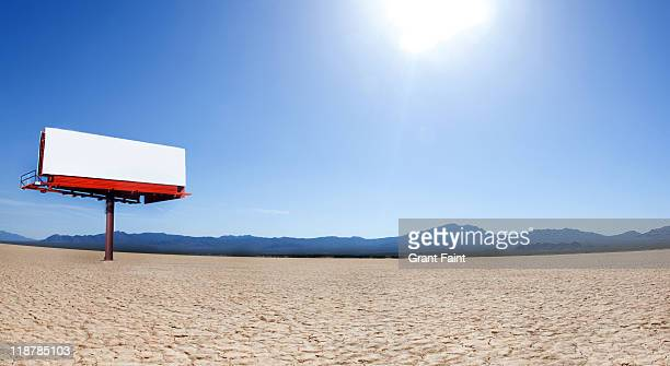 Blank billboard in desert.