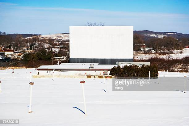 Blank billboard in snowy rural area