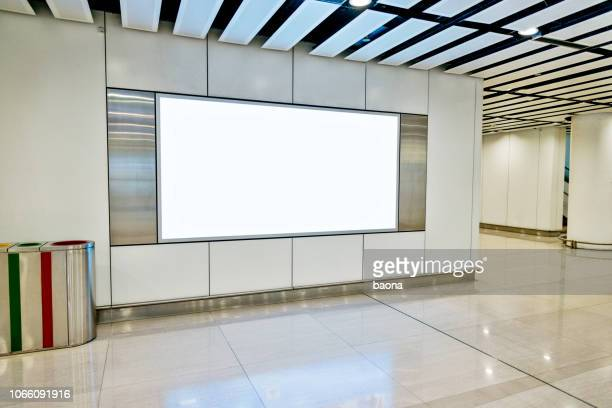 blank billboard in subway station - template stock pictures, royalty-free photos & images