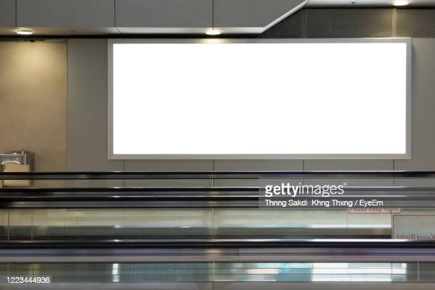 blank billboard in the airport - advertisement stock pictures, royalty-free photos & images