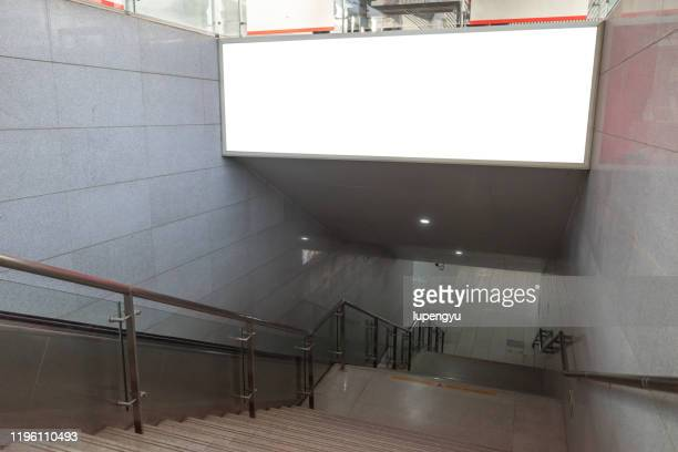 blank billboard in underground hall or subway - commercial sign stock pictures, royalty-free photos & images