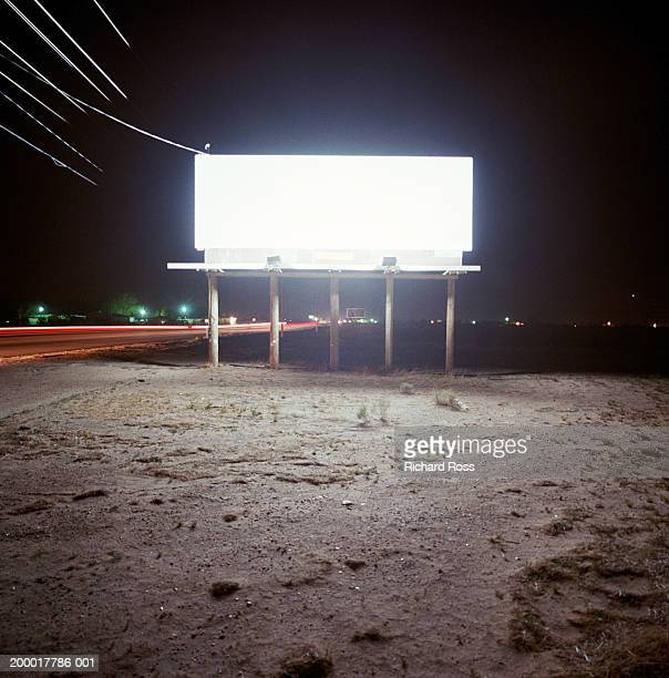 Blank billboard lit up at night