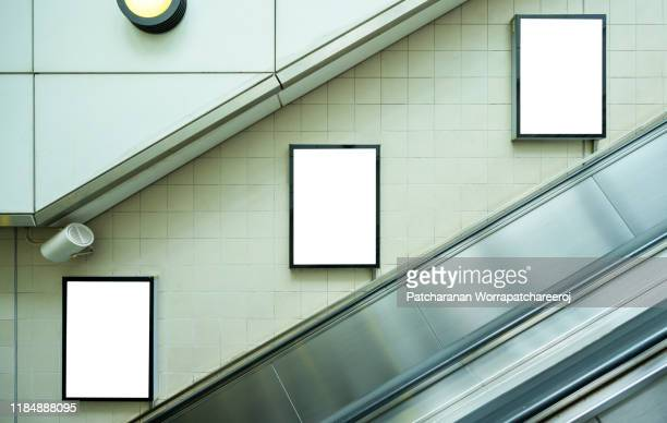 blank billboard mock up on the wall beside the escalator at the subway station. advertising concept - template stock pictures, royalty-free photos & images