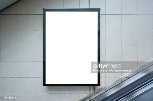 blank billboard mock up on the wall beside the escalator at the subway station. advertising concept - blank stock pictures, royalty-free photos & images