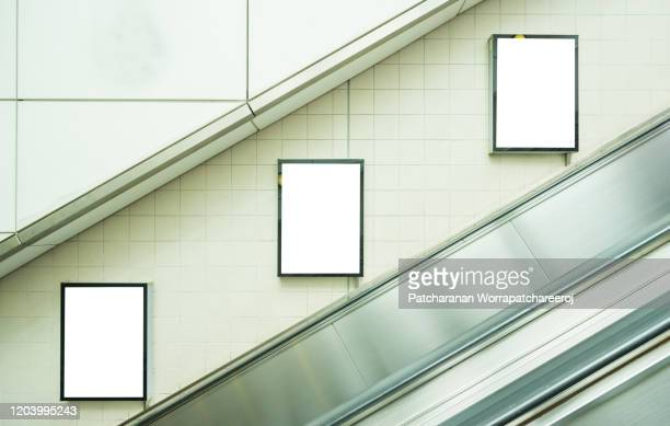 blank billboard mock up on the wall in subway station. advertising concept - billboard stock pictures, royalty-free photos & images