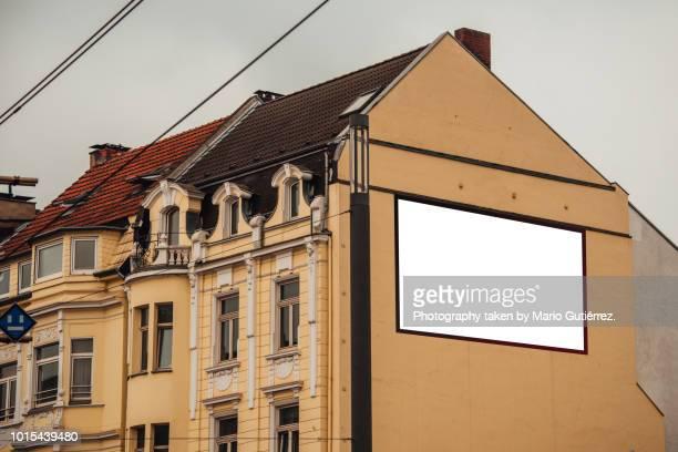 Blank billboard on building facade