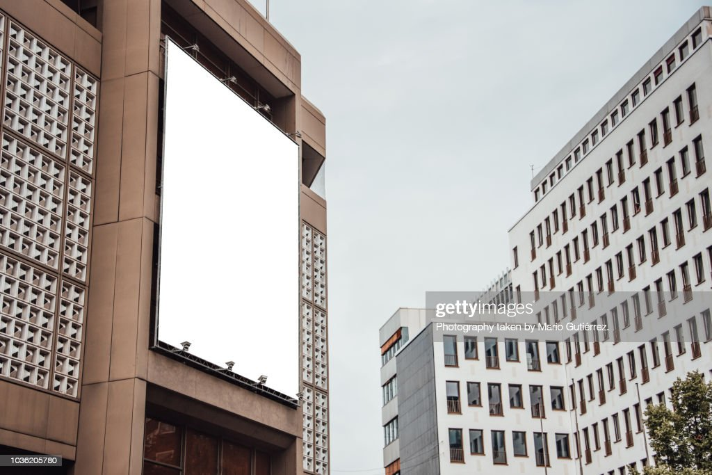 Blank billboard on building facade : Stock Photo