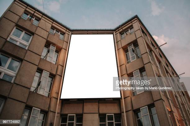 blank billboard on building facade - commercial sign stock pictures, royalty-free photos & images