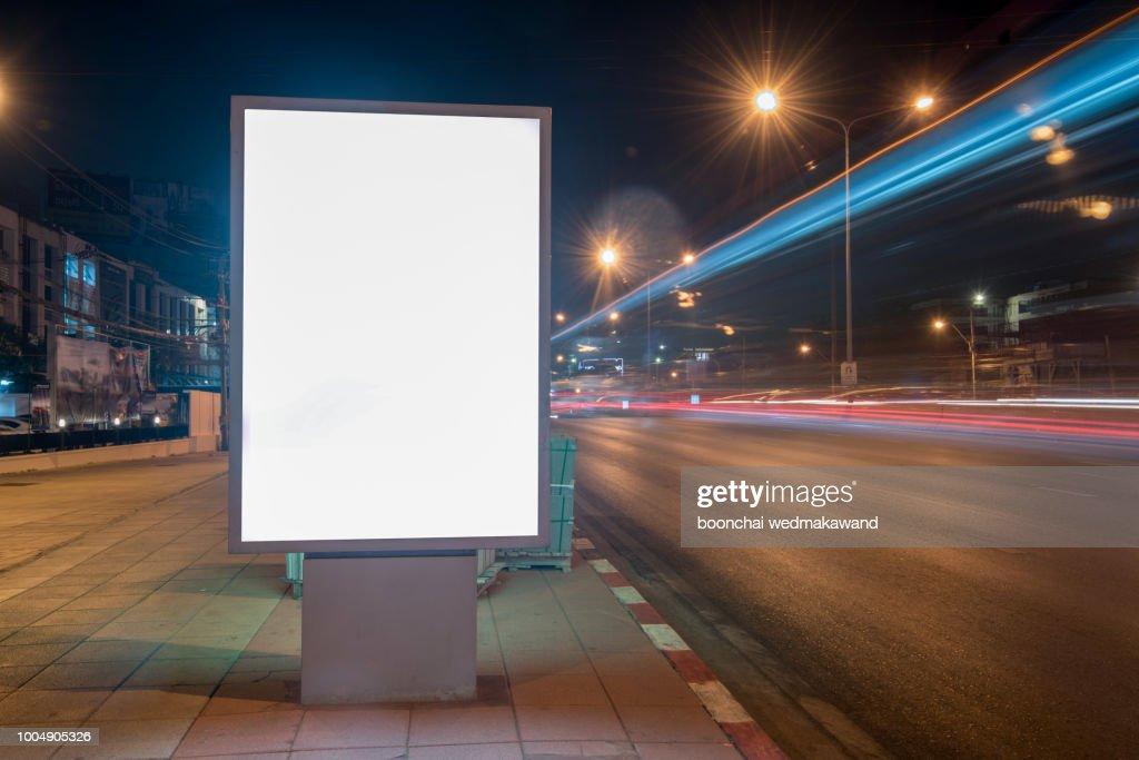 Blank Billboard on City Street at Night. Outdoor advertising : Stock Photo