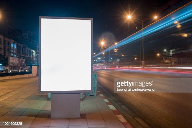 blank billboard on city street at night. outdoor advertising - template stock pictures, royalty-free photos & images