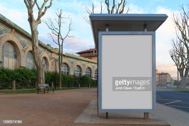 blank billboard on footpath in city - advertisement stock pictures, royalty-free photos & images