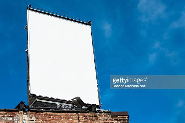 PORTUGAL TORONTO ONTARIO CANADA Blank billboard on rooftop of building with blue sky in the background Advertisement board fixed on top of a building