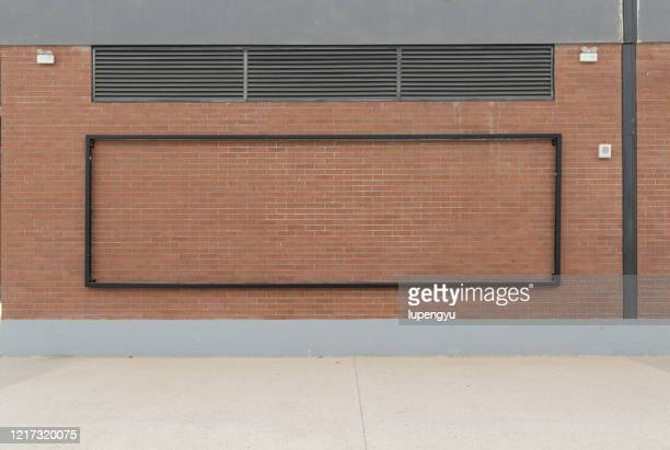 blank billboard on the brick wall - street stock pictures, royalty-free photos & images