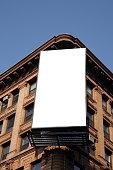 Blank billboard on the corner of an apartment block