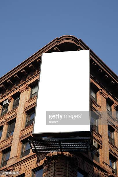 blank billboard on the corner of an apartment block - vertical stock pictures, royalty-free photos & images