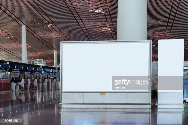 blank billboard on the corridor of airport - airport stock pictures, royalty-free photos & images