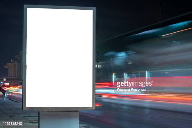 blank billboard on the highway during the twilight with city background with clipping path on screen.- can be used for display your products or promotional - farola fotografías e imágenes de stock