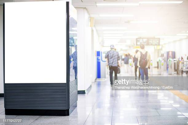 blank billboard on window at subway station - subway station stock pictures, royalty-free photos & images