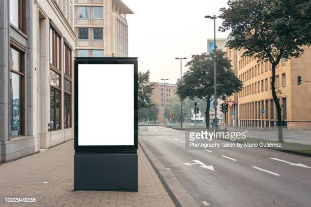 blank billboard outdoors - street stockfoto's en -beelden