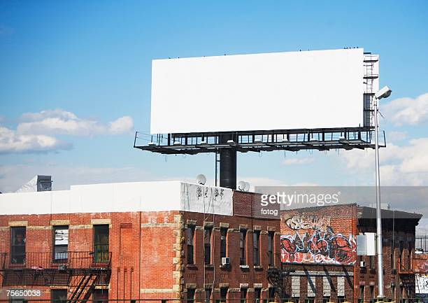 Blank billboard over urban buildings