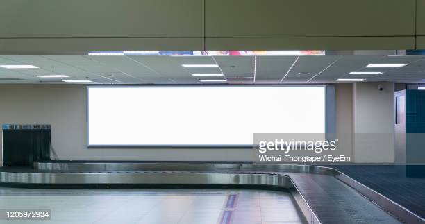 blank billboard posters in the airport . - advertisement stock pictures, royalty-free photos & images
