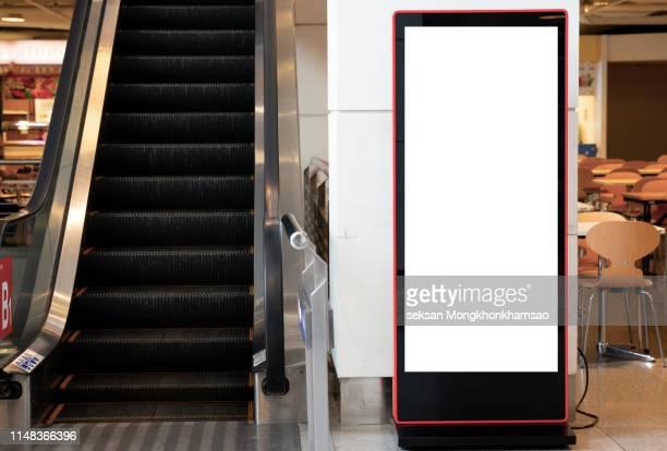 blank billboard posters in the airport,empty advertising billboard at aerodrome - copy space imagens e fotografias de stock