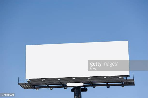Blank billboard under blue sky