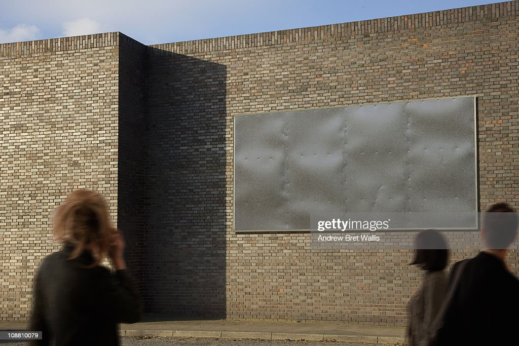 blank billboard with passing pedestrians : Stock Photo