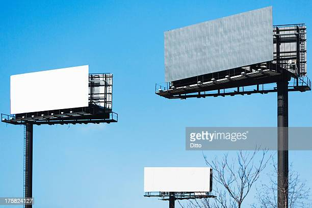 Blank billboards against blue sky