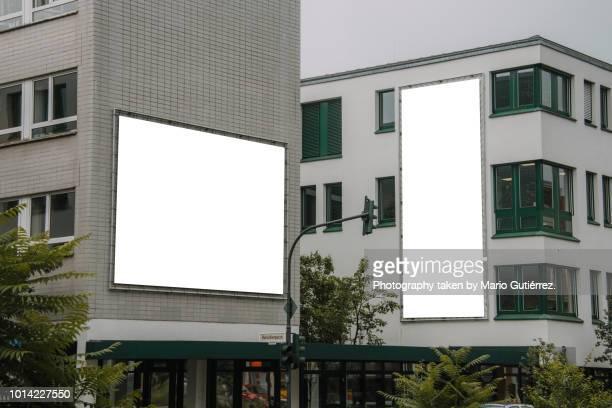 Blank billboards on building facade