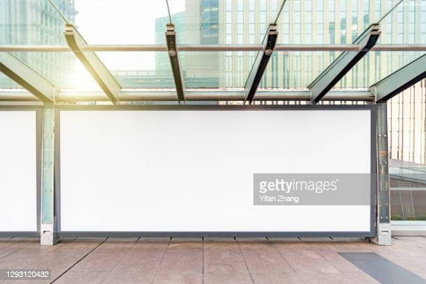 blank billboards on sidewalks in lujiazui financial district, pudong, shanghai at daytime - shanghai billboard stock pictures, royalty-free photos & images