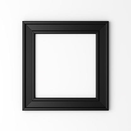 blank black photo frame on white wall 484950168