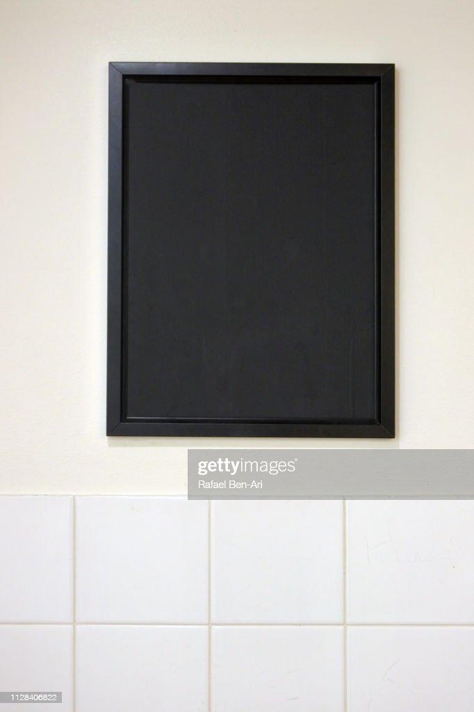 Blank BlackBoard on a Wall : Stock Photo