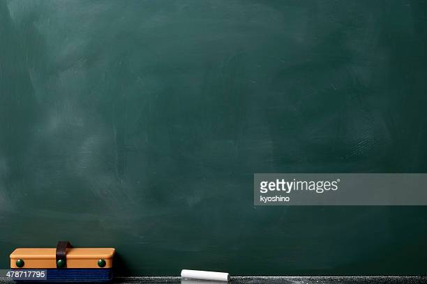 blank blackboard with board eraser - blackboard stock photos and pictures