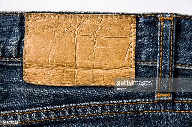 a blank blue jeans leather label - denim stock pictures, royalty-free photos & images