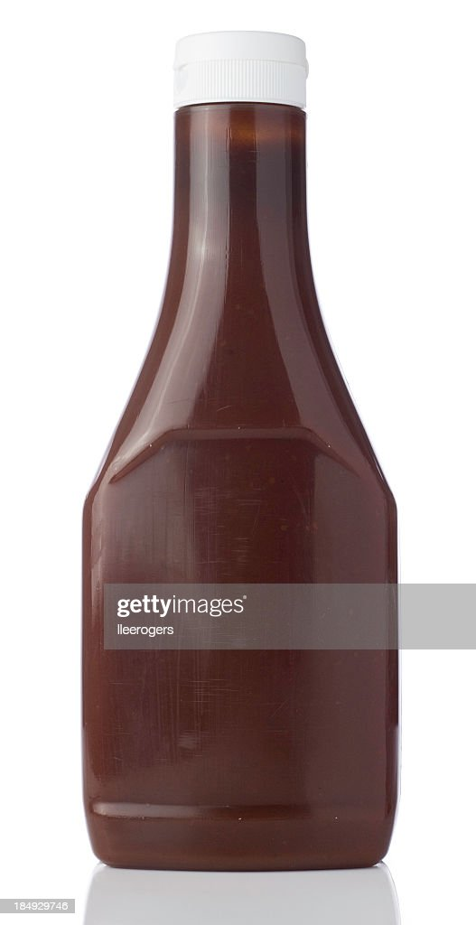 Blank bottle containing a brown liquid with a squirt top lid : Stock Photo